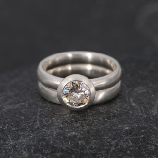 Brilliant Cut Moissanite wedding ring set in silver.