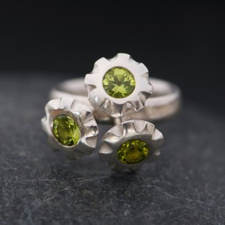 Triple peridot flower ring in silver