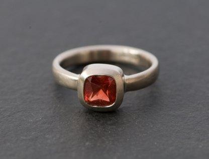 Square red Oregon sunstone in white gold ring