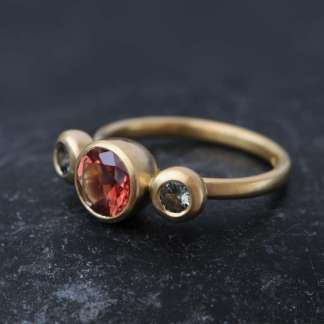 Triple-stone ring set with Montana sapphires and oregon sunstone