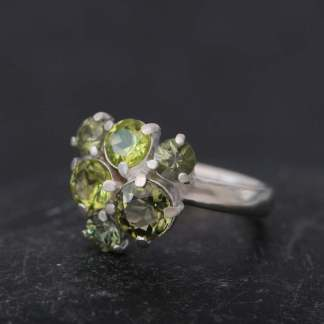Unusual cluster ring claw set with green stones