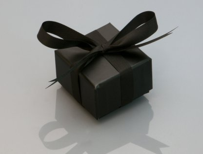 black box tied up with black ribbon