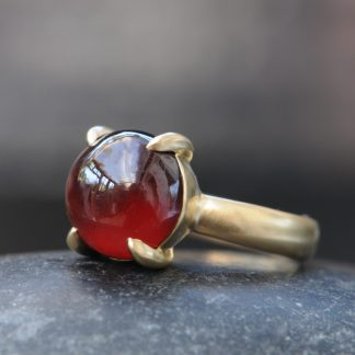 red garnet cab 12mm dragonseye ring in 18K