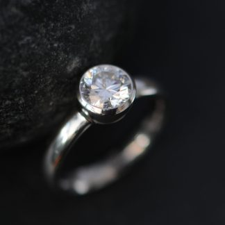 moissanite 6mm round bezel set in platinum