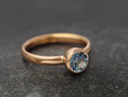 aquamarine AAAA 7mm bezel set in 18K r gold