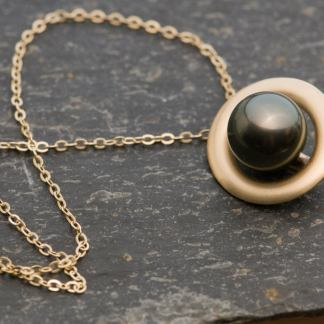 black pearl halo necklace in 9k gold
