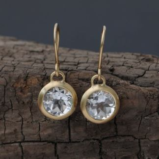 white topaz drop earrings in 18K yellow gold
