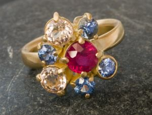 ruby and sapphire cluster ring in gold.