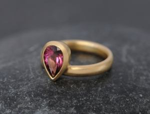 pink tourmaline pear cut ring in 18K y gold