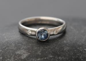 montana sapphire 5mm in platinum with diamonds