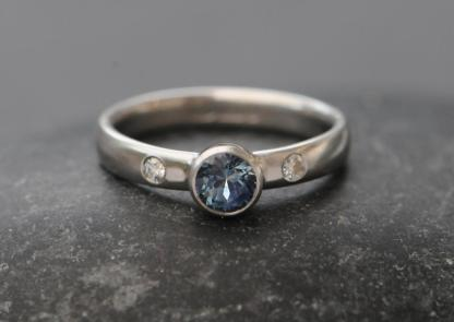 montana sapphire 5mm in platinum with diamonds
