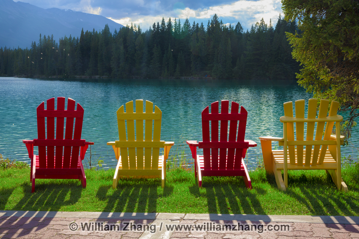 Chairs and shadows at edge of lake in Jasper National Park