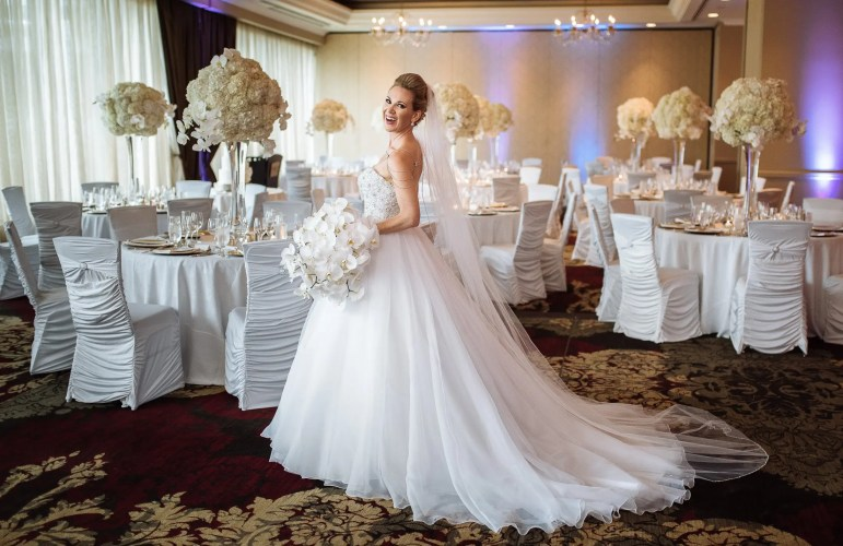 bride with wedding details and decor