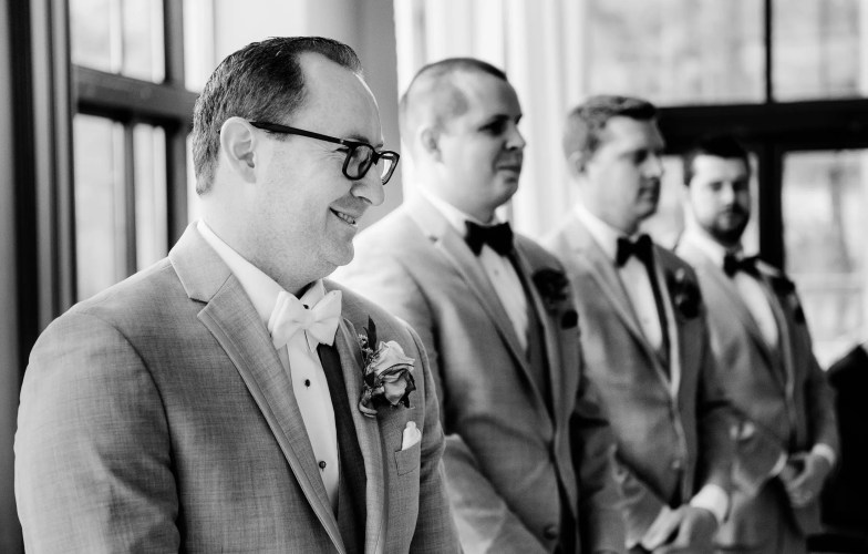 groom first look down during wedding ceremony