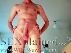 Man standing up, showing erect penis from below
