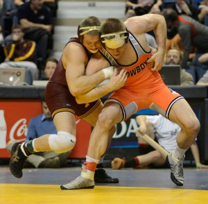 Oklahoma State's Chris Perry (right) defeated Minnesota's Logan Storley in the Southern Scuffle final but lost to the Gopher in the NWCA  National Duals