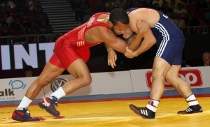 Angel Escobedo (left) led 1-0 in the first period of his bronze medal match to Turkey's Sezar Akgul before losing 2-1. The former Indiana All-American finished 3-2 on the day in Hungary. (Photo by Bob Mayeri)