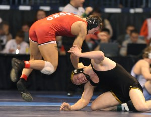 Edinboro's Vic Avery pushed down the head of Iowa's Ethen Lofthouse as the 184-pound Fighting Scot upset No. 5 seed Hawkeye, 5-3. (Tim Tushla photo)