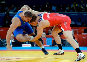 Jake Varner (right) became the first non-Russian in four Olympics to win an Olympic gold medal at 211.5 pounds in 2012.