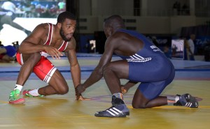 "Jordan Burroughs (left) believes he ""tweaked"" his left knee in his first-round match over Augusto Midana of Guinea Bisau. (Bob Mayeri image)"