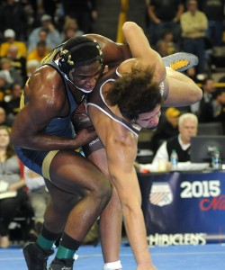 J'den Cox (left) clinched Missouri's first appearance in National Duals since 2007 with a 4-0 win over Lehigh's Elliot Riddick.(Ginger Robinson photo)