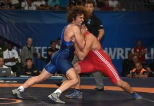 Jordan Holm (left) went 0-1 for a second straight Worlds as Greco-Roman concluded action on Wednesday. (Ginger Robinson photo)