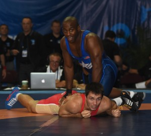 Justin Lester thought he pinned Russia's Adam Kurak but lost 10-9 in his repechage bout. (Ginger Robinson photo)