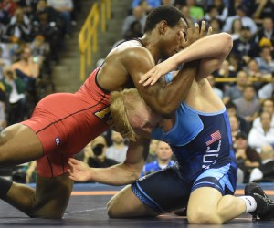 J'den Cox (left) set the upset tone of his victory over Kyle Dake when the two-time NCAA champ from Missouri outscored Dake 8-1 in the first match at 85k/189 pounds