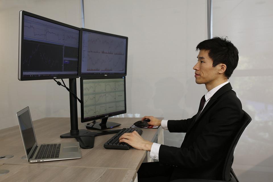 courtier en bourse trader