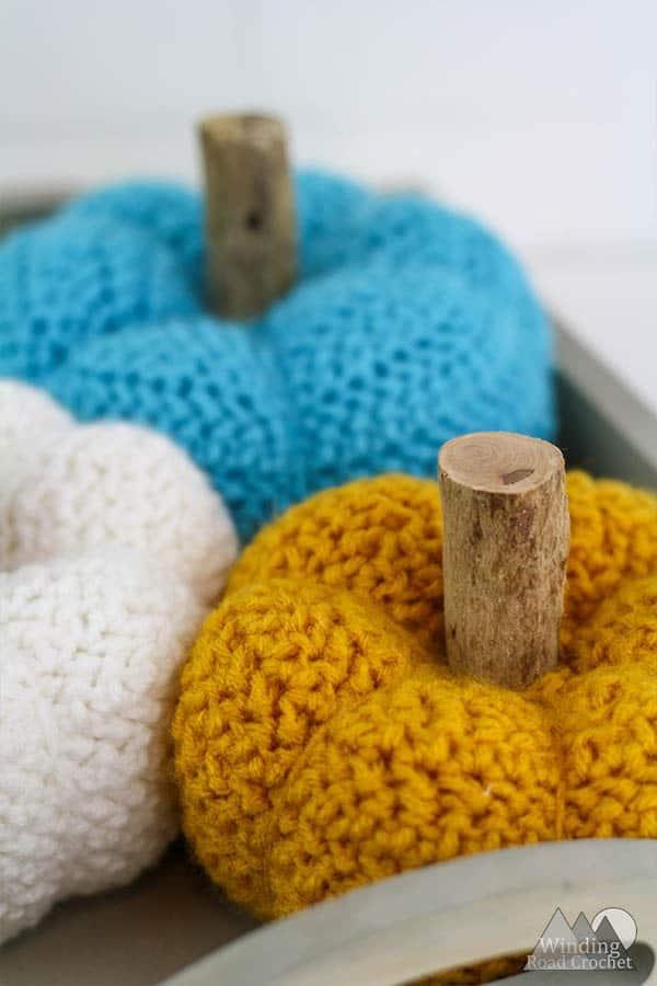 Pretty Little Crochet Pumpkin Free Pattern   This little pumpkin is great for your fall decorations. This crochet pumpkin has a unique texture and is a fun quick project. #pumpkin #crochet #crochetpumpkin #fallcrochet