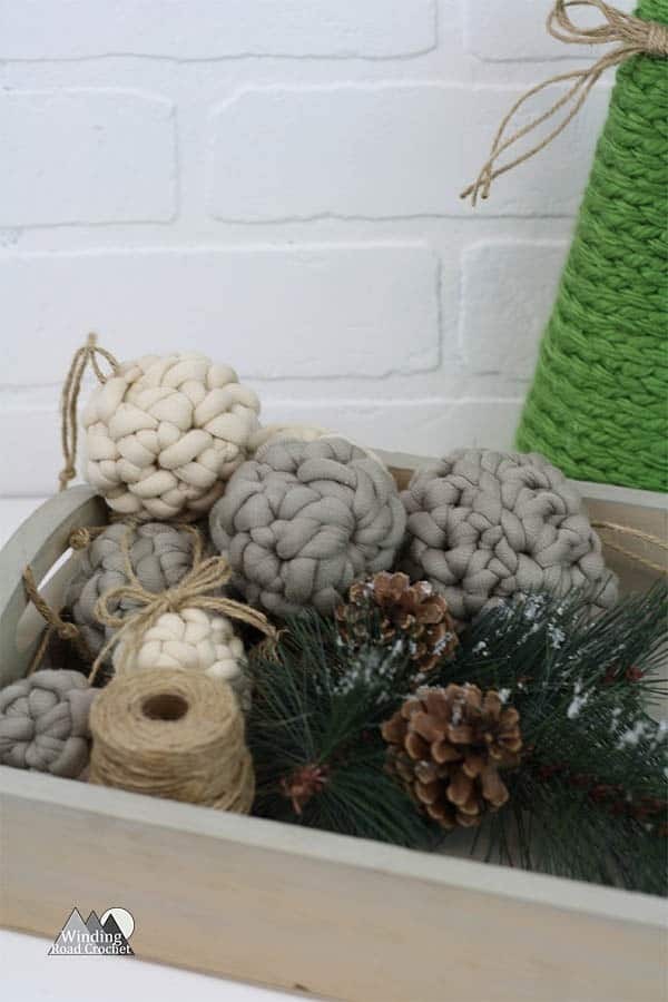 Rustic Crochet Ornaments | Crochet these rustic farmhouse chic ornaments in just minutes. These ornaments take very little chunky yarn and can be crocheted in minutes. Quick and easy and perfect for beginners. These Christmas ornaments uses the basic crochet stitches and can be made in three different sizes. This is a must have free crochet pattern for the holidays. #christmasornaments #crochet #crochetornaments