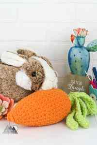 The Crochet Carrot is a quick and easy amigurumi crochet project that makes a perfect spring and easter photo prop. Use this free crochet pattern to add interest to a baby or kids easter photos. #eastercrochet #crochetphotoprops #crochetcarrot