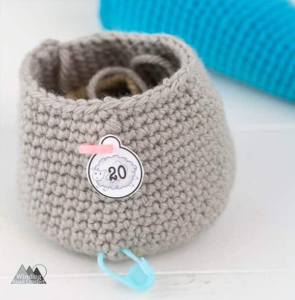 Learn how to use crochet stitch markers and some extra tips and tricks for using stitch markers. Also learn where to get the printable stitch marker tags. #crochettips #stitchmarkers #crochetstitchmarkers