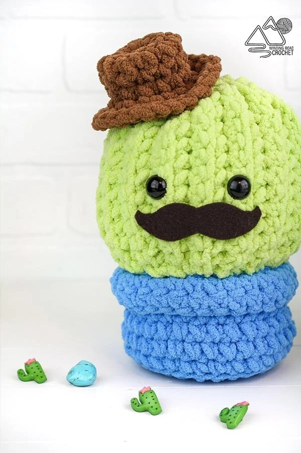 This quick and easy crochet cactus is perfect for summer home decor or as a plushie for kids and babies. Free crochet pattern by Winding Road Crochet. #crochetcactus #crochetplush #cactuspillow