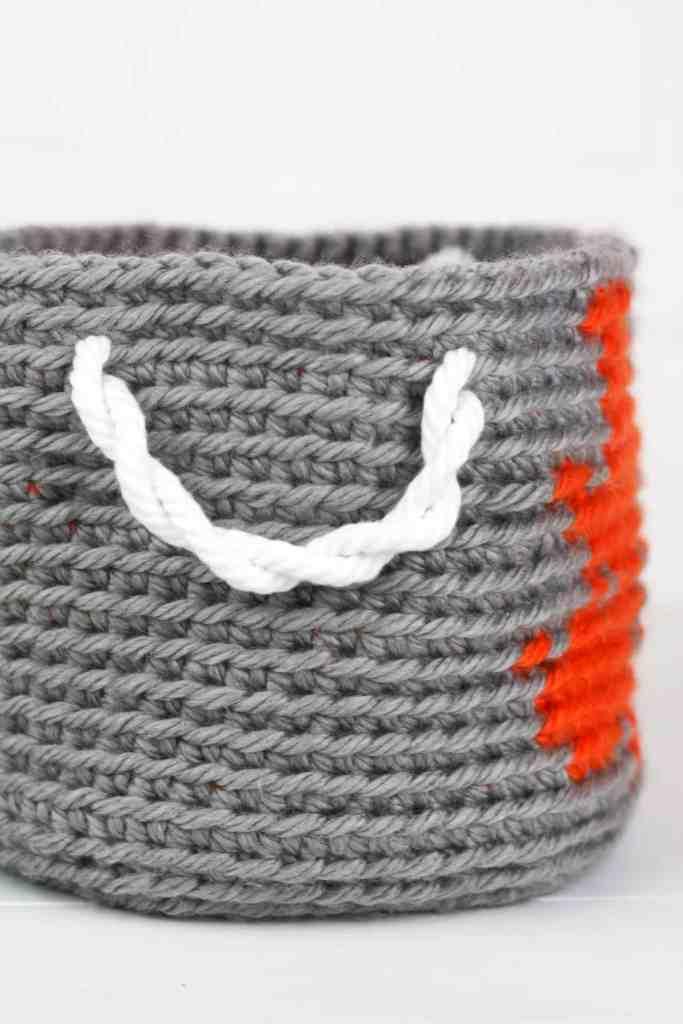 Crochet Dinosaur Basket, the first free pattern in a series of three nesting crochet baskets. Design by Winding Road Crochet. #dinosaur #crochetdinosaur #crochetbasket #crochethomedecor