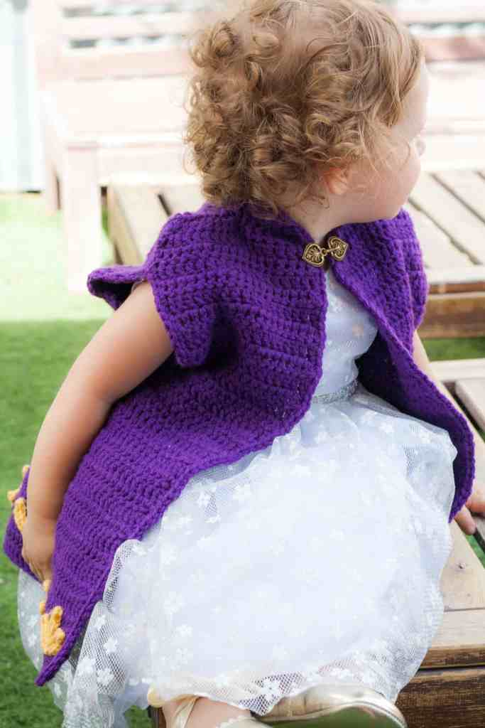 Don't let your girl be a frozen princess on Halloween. Keep her warm with this Crochet Cape Coat. Free crochet pattern by Winding Road Crochet. #crochetprincess #crochetcape #crochetcostume #frozen