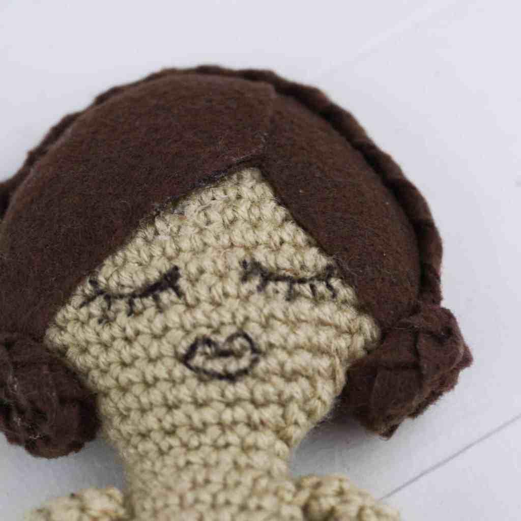 The Heirloom crochet doll is sure to be a treasured gift. Free crochet pattern by Winding Road Crochet. #crochetdoll #ragdoll #vintagedoll