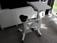 This desk from FlexiSpot has an exercise bike built into it