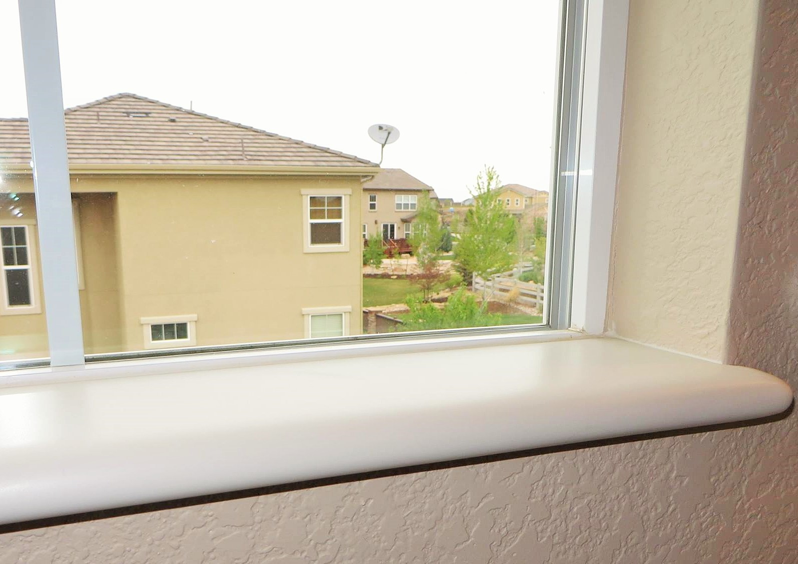 CORIAN Bisque sill with bullnose edge