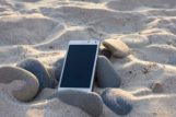 phone on beach sand
