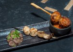 Skewers: Chicken meatball/Tsukune, Togarashi, Jidori egg; Trumpet mushroom/Eringi, Furikake and Beef tongue/Gyutan, sesame, lemon, scallion. (Edgar Solís)