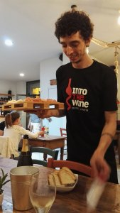 Davide of Into The Wine, introducing us to some of the local delicacies. Pinerolo, July 2016.