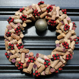 Wine cork Christmas wreath hanging on door