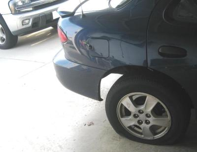 This one's a two-fer…you get to see not only my lovely flat tire, but also the damage I inflicted upon my truck.