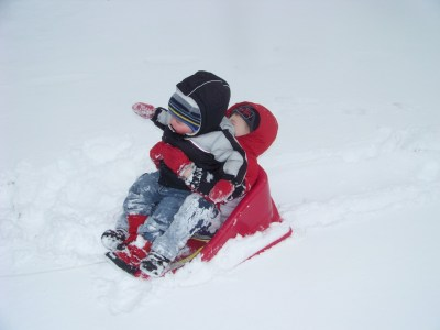 smashed both kids onto the baby sled--don't they look like they're having fun?