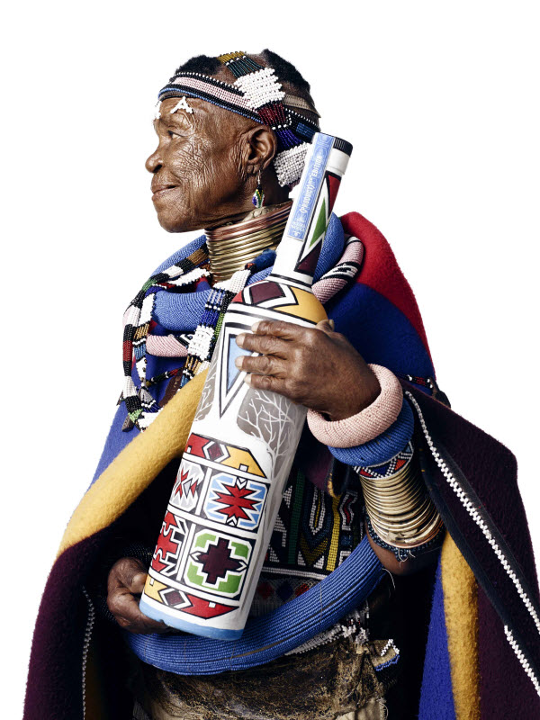 Esther Mahlangu with handpainted bottle