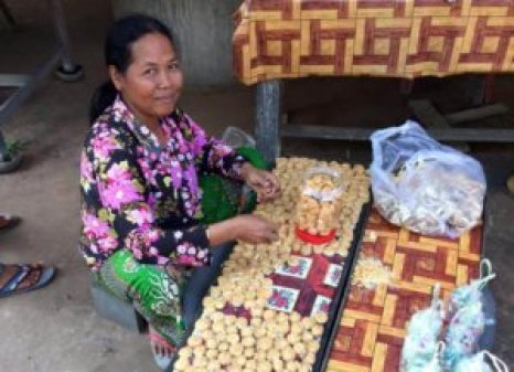 A Cambodian street vendor with palm sugar sweets. One of the most important travel commandments is to learn from those around us!