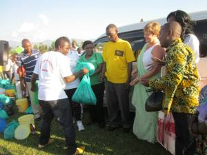 A group of volunteers interacting with a man