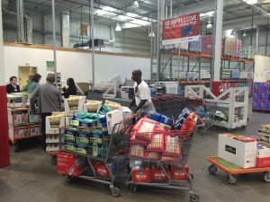 A group of people buying a large amount of donated goods from a Costco