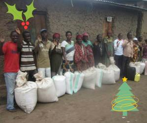 People standing with bags of rice